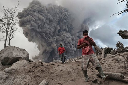 Residents around Mount Sinabung, in North Sumatra, flee for their lives after the volcano erupted. T