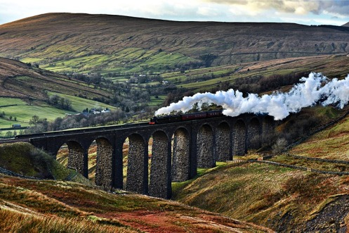 The Scots Guardsman locomotive hauls the Cumbrian Mountain Express over a viaduct